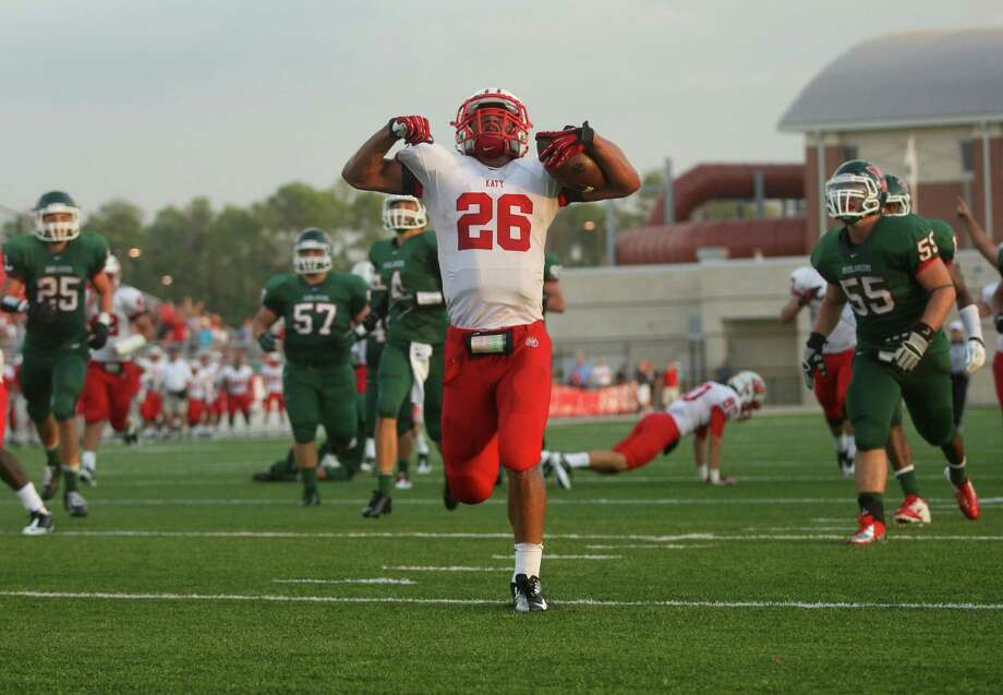 Katy's Rodney Anderson (26) puts an exclamation mark on his 35-yard touchdown run in the first half against The Woodlands on Saturday night. Photo: Eric Christian Smith