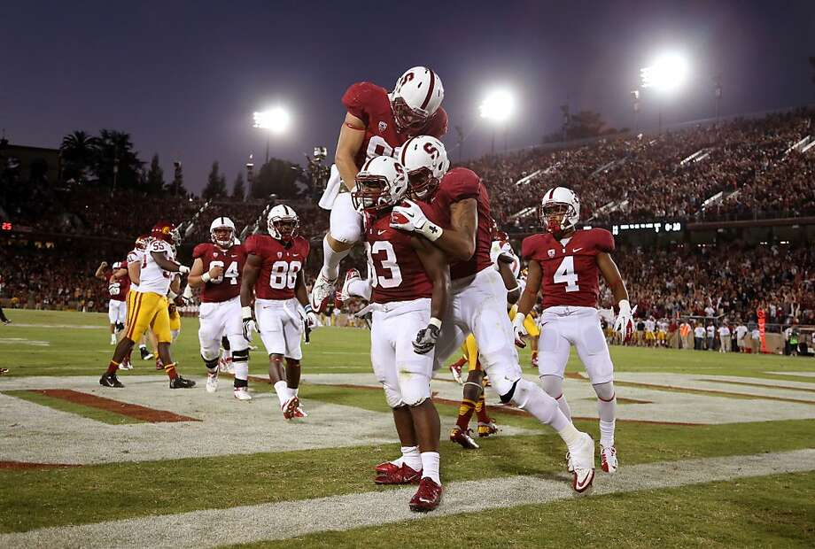 PALO ALTO, CA - SEPTEMBER 15:  Stepfan Taylor #33 of the Stanford Cardinal is congratulated by teammates after he ran in for a touchdown against the USC Trojans at Stanford Stadium on September 15, 2012 in Palo Alto, California.  (Photo by Ezra Shaw/Getty Images) Photo: Ezra Shaw, Getty Images