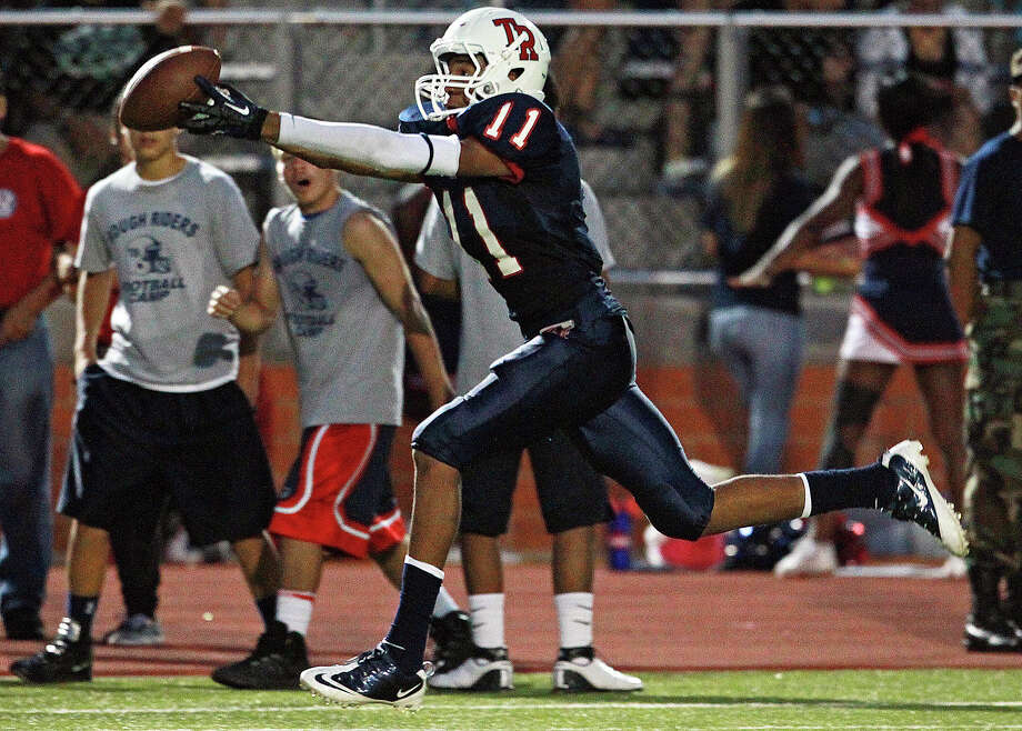 Marcel Mayes gets the ball to stick to his fingertips as he hauls in a long touchdown reception in the second quarter as Roosevelt hosts Canyon at Heroes Stadium on September 15, 2012. Photo: Tom Reel, Express-News / ©2012 San Antono Express-News