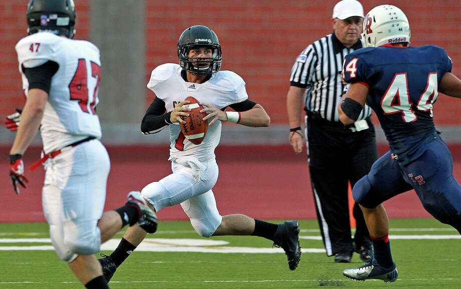 Cougar quarterback Philip Shelton sprints to his right looking for a receiver as Roosevelt hosts Canyon at Heroes Stadium on September 15, 2012. Photo: Tom Reel, Express-News / ©2012 San Antono Express-News