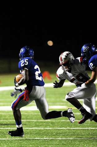 West Brook running back Justin Hervey makes a great run against Lamar  at the end of the first quarter at the Beaumont ISD Thomas Center on Saturday, September 15, 2012. Photo taken: Randy Edwards/The Enterprise