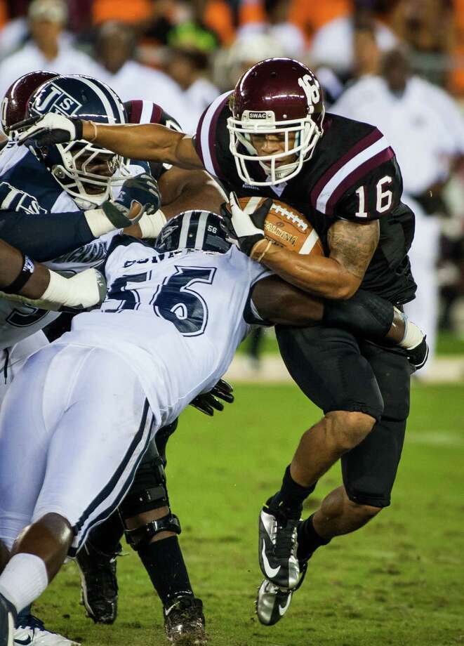 TSU running back Edward Perkins-Loving, right, tries to break free from Jackson State's Javarius Conner during the Tigers' first game at their new home - BBVA Compass Stadium. Photo: Andrew Richardson / © 2012 Andrew Richardson