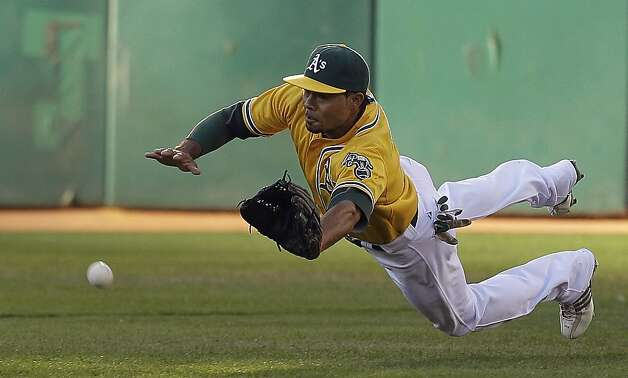 Oakland Athletics center fielder Coco Crisp cannot make the catch on a ball hit by Baltimore Orioles' Nate McLouth that fell for a single in the first inning of a baseball game on Saturday, Sept. 15, 2012, in Oakland, Calif. (AP Photo/Ben Margot) Photo: Ben Margot, Associated Press
