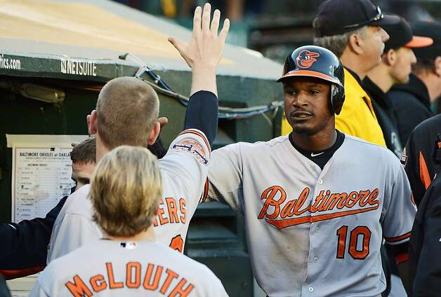OAKLAND, CA - SEPTEMBER 15:  Adam Jones #10 of the Baltimore Orioles is congratulated by teammates after he scored on a Mark Reynolds #12 (not pictured) RBI double in the second inning against the Oakland Athletics at O.co Coliseum on September 15, 2012 in Oakland, California.  (Photo by Thearon W. Henderson/Getty Images) Photo: Thearon W. Henderson, Getty Images