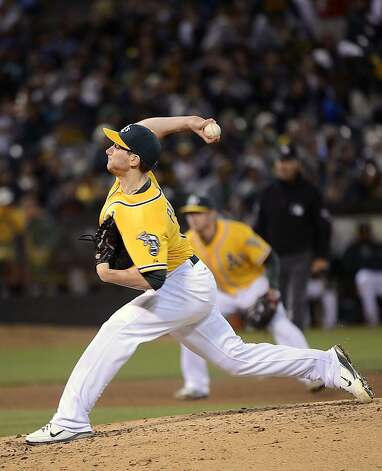OAKLAND, CA - SEPTEMBER 15:  Jarrod Parker #11 of the Oakland Athletics pitches in the six inning against the Baltimore Orioles at O.co Coliseum on September 15, 2012 in Oakland, California.  (Photo by Thearon W. Henderson/Getty Images) Photo: Thearon W. Henderson, Getty Images