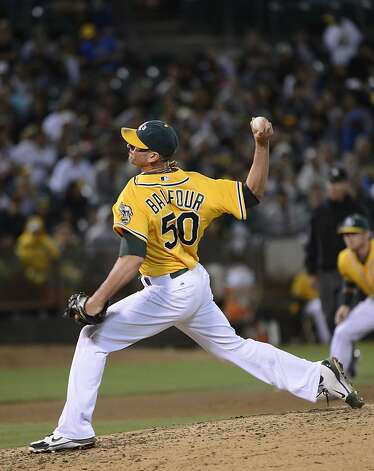 OAKLAND, CA - SEPTEMBER 15:  Grant Balfour #50 of the Oakland Athletics pitches in the ninth inning against the Baltimore Orioles at O.co Coliseum on September 15, 2012 in Oakland, California. The Athletics won the game 5-2. (Photo by Thearon W. Henderson/Getty Images) Photo: Thearon W. Henderson, Getty Images
