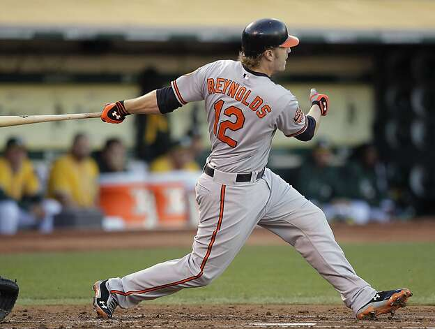 Baltimore Orioles' Mark Reynolds swings for a two-run double off Oakland Athletics' Jarrod Parker in the second inning of a baseball game on Saturday, Sept. 15, 2012, in Oakland, Calif. (AP Photo/Ben Margot) Photo: Ben Margot, Associated Press