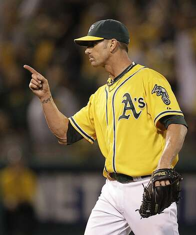 Oakland Athletics' Grant Balfour celebrates at the end of a baseball game against the Baltimore Orioles, Saturday, Sept. 15, 2012, in Oakland, Calif. (AP Photo/Ben Margot) Photo: Ben Margot, Associated Press
