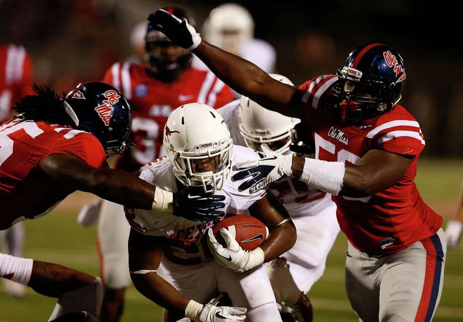 OXFORD, MS - SEPTEMBER 15:  Malcolm Brown #28 of the Texas Longhorns is tackled by Woodrow Hamilton #56  the Ole Miss Rebels at Vaught-Hemingway Stadium on September 15, 2012 in Oxford, Mississippi. Photo: Scott Halleran, Getty Images / 2012 Getty Images