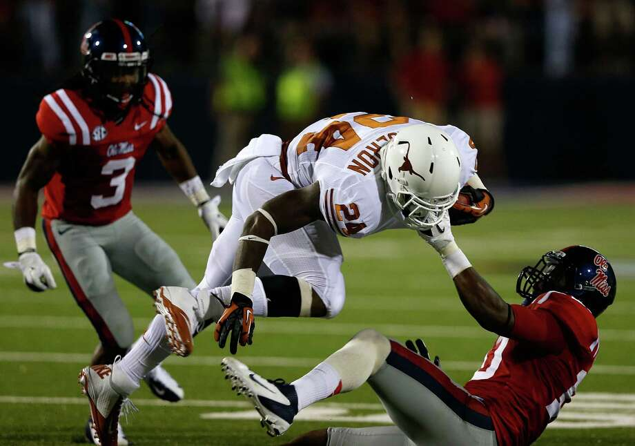 OXFORD, MS - SEPTEMBER 15:  Joe Bergeron #24 of the Texas Longhorns is tackled by C.J. Johnson #10 of the Ole Miss Rebels at Vaught-Hemingway Stadium on September 15, 2012 in Oxford, Mississippi. Photo: Scott Halleran, Getty Images / 2012 Getty Images