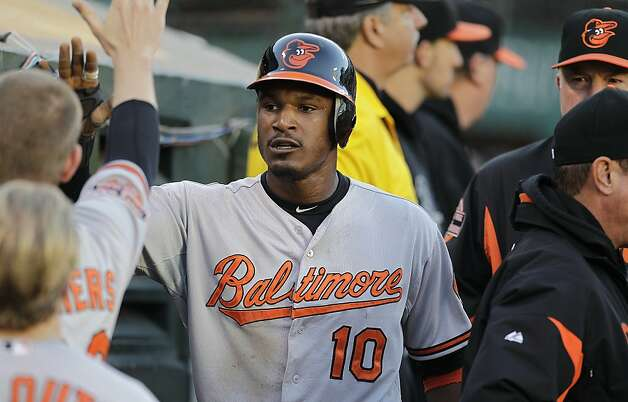 Baltimore Orioles' Adam Jones (10) is congratulated after scoring against the Oakland Athletics in the second inning of a baseball game on Saturday, Sept. 15, 2012, in Oakland, Calif. Jones scored on a double by Mark Reynolds. (AP Photo/Ben Margot) Photo: Ben Margot, Associated Press