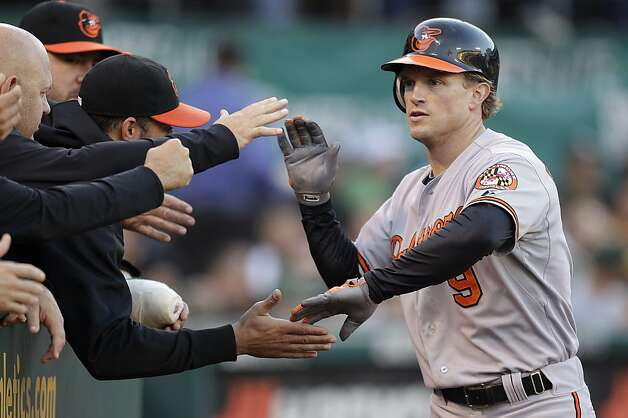 Baltimore Orioles' Nate McClouth, right, is congratulated after hitting a home run off Oakland Athletics' Jarrod Parker in the third inning of a baseball game on Saturday, Sept. 15, 2012, in Oakland, Calif. (AP Photo/Ben Margot) Photo: Ben Margot, Associated Press