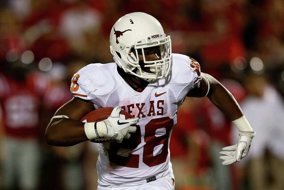 OXFORD, MS - SEPTEMBER 15:  Malcolm Brown #28 of the Texas Longhorns runs upfield against the Ole Miss Rebels at Vaught-Hemingway Stadium on September 15, 2012 in Oxford, Mississippi. Photo: Scott Halleran, Getty Images / 2012 Getty Images