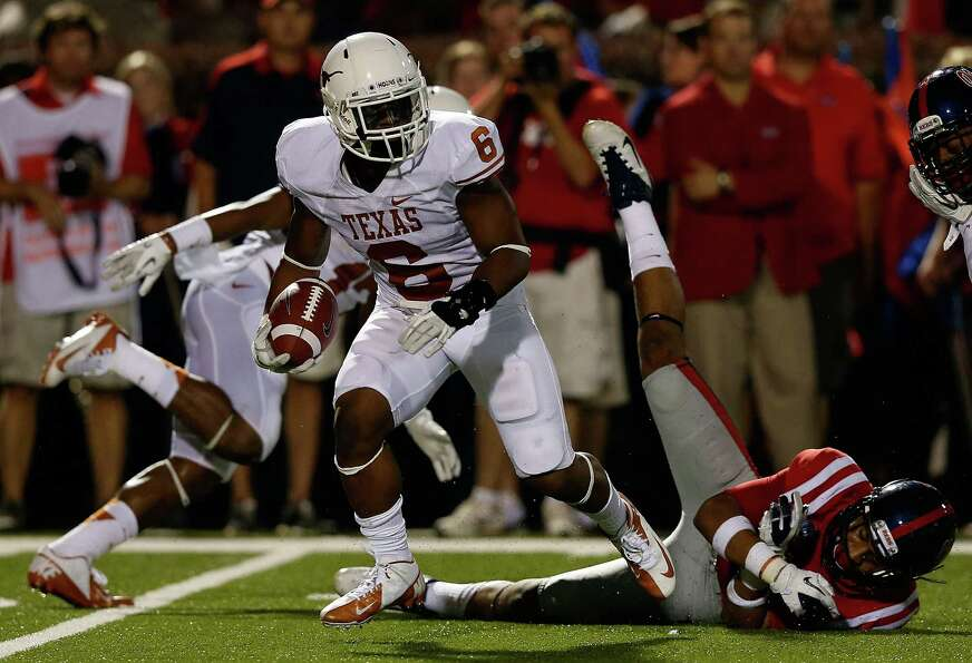OXFORD, MS - SEPTEMBER 15:  Quandre Diggs #6 of the Texas Longhorns hauls in an interception in fron