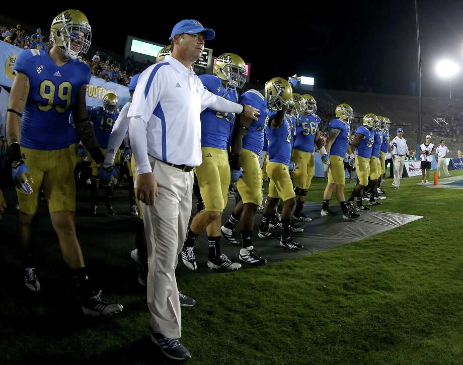 PASADENA, CA - SEPTEMBER 15:  Head coach Jim Mora of the UCLA Bruins brings his team onto the field for the game with the Houston Cougars at the Rose Bowl on September 15, 2012 in Pasadena, California. Photo: Stephen Dunn, Getty Images / 2012 Getty Images