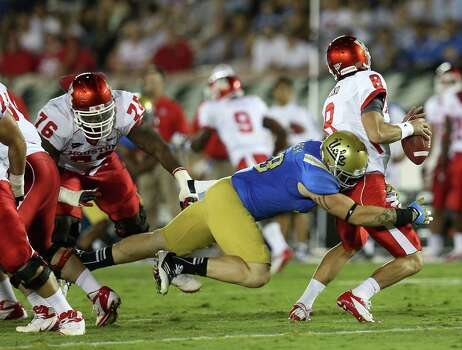 PASADENA, CA - SEPTEMBER 15: Defensive Cassius Marsh #99 of the UCLA Bruins sacks quarterback David Piland #8 of the Houston Cougars at the Rose Bowl on September 15, 2012 in Pasadena, California. Photo: Stephen Dunn, Getty Images / 2012 Getty Images