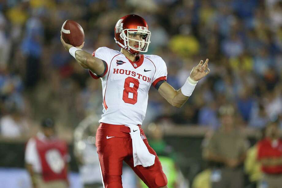 PASADENA, CA - SEPTEMBER 15:  Quarterback David Piland #8 of the Houston Cougars throws a pass against the UCLA Bruins at the Rose Bowl on September 15, 2012 in Pasadena, California. Photo: Stephen Dunn, Getty Images / 2012 Getty Images