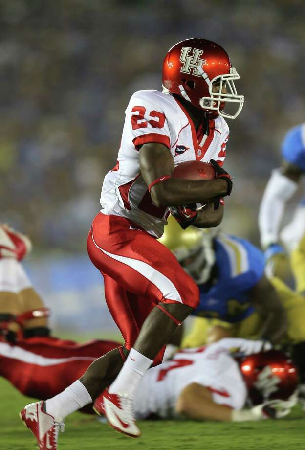 PASADENA, CA - SEPTEMBER 15:  Running back Ryan Jackson #22 of the Houston Cougars carries the ball against the UCLA Bruins at the Rose Bowl on September 15, 2012 in Pasadena, California. Photo: Stephen Dunn, Getty Images / 2012 Getty Images