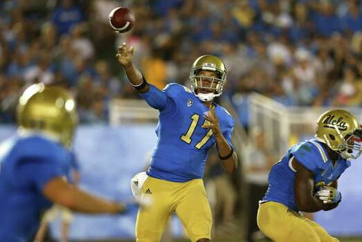 PASADENA, CA - SEPTEMBER 15:  Quarterback Brett Hundley #17 of the UCLA Bruins throws a pass against the Houston Cougars at the Rose Bowl on September 15, 2012 in Pasadena, California. Photo: Stephen Dunn, Getty Images / 2012 Getty Images