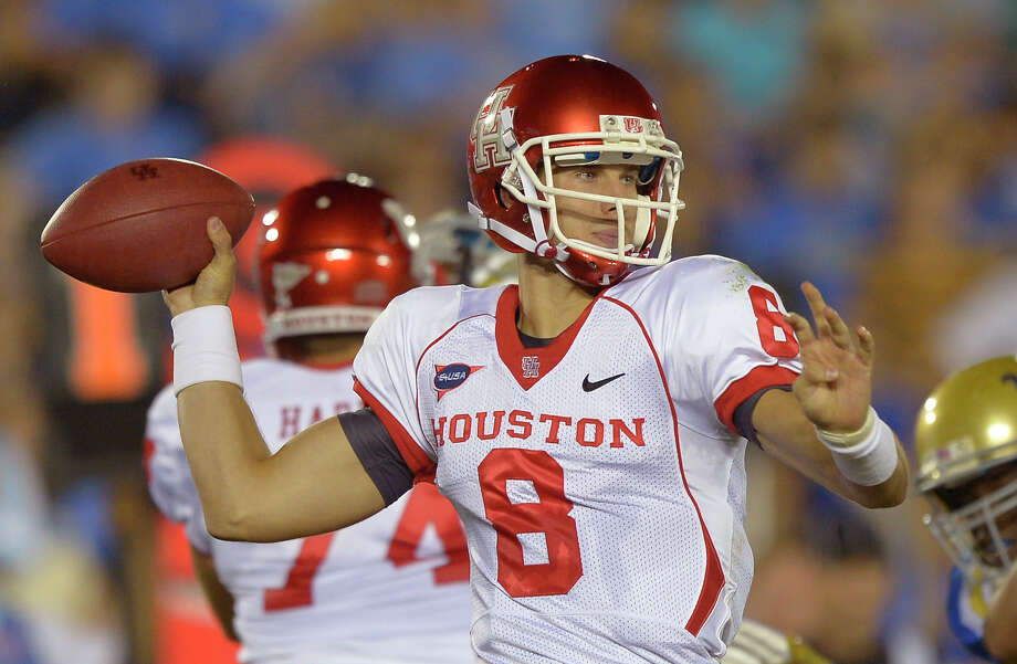 Houston quarterback David Piland passes during the first half of their NCAA college football game against UCLA, Saturday, Sept. 15, 2012, in Pasadena, Calif.  (AP Photo/Mark J. Terrill) Photo: Mark J. Terrill, Associated Press / AP