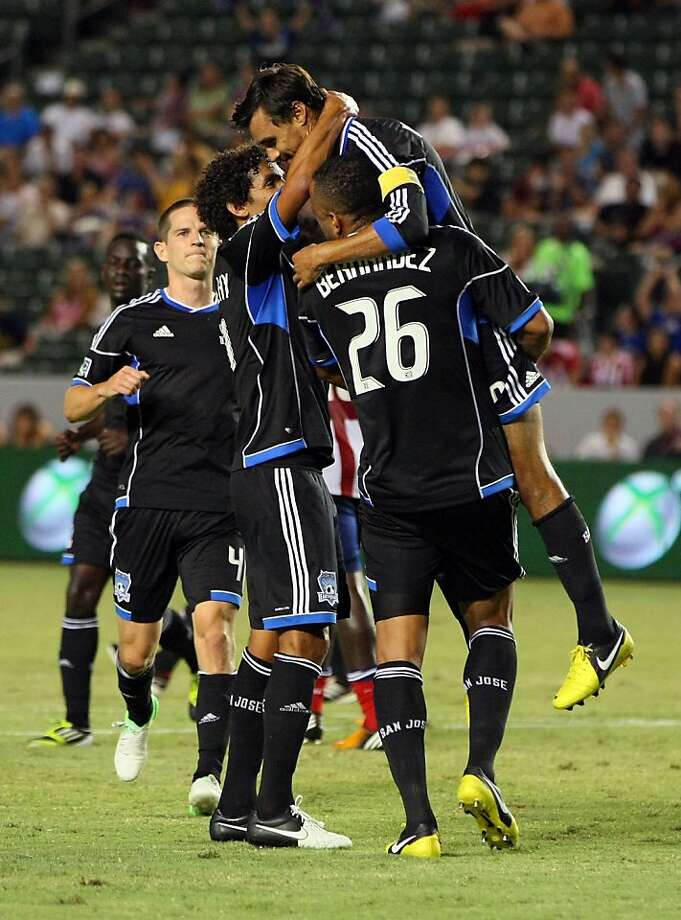 CARSON, CA - SEPTEMBER 15:  Captain Chris Wondolowski #8 of the San Jose Earthquakes celebrates with teammates Mehdi Ballouchy #11 and Victor Bernardez #26 after Wondolowski converted a penalty kick in the first half against Chivas USA at The Home Depot Center on September 15, 2012 in Carson, California.  (Photo by Victor Decolongon/Getty Images) Photo: Victor Decolongon, Getty Images
