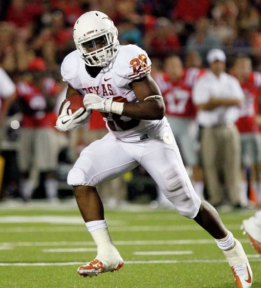 Texas running back Malcolm Brown looks for blockers as he runs for a short gain against Mississippi in the second quarter of an NCAA college football game in Oxford, Miss., Saturday, Sept. 15, 2012. (AP Photo/Rogelio V. Solis) Photo: Rogelio V. Solis, Associated Press / AP