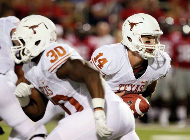 Texas fullback Ryan Roberson (30) sets up to block as quarterback David Ash (14) looks to hand off during the first quarter of an NCAA college football game against Mississippi in Oxford, Miss., Saturday, Sept. 15, 2012. (AP Photo/Rogelio V. Solis) Photo: Rogelio V. Solis, Associated Press / AP