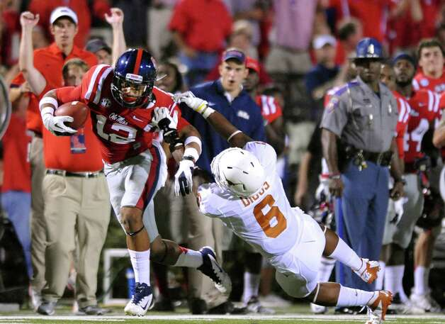 Mississippi wide receiver Donte Moncrief (12) breaks away from Texas' Quandre Diggs (6)  during an NCAA college football game in Oxford, Miss., on Saturday, Sept. 15, 2012. (AP Photo/Oxford Eagle, Bruce Newman) MAGS OUT  NO SALES  MANDATORY CREDIT Photo: Bruce Newman, Associated Press / Oxford Eagle