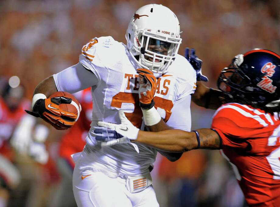 Texas linebacker Steve Edmond (33) runs back an interception of a Mississippi pass during the first quarter of an NCAA college football game in Oxford, Miss., Saturday, Sept. 15, 2012. (AP Photo/Austin McAfee) Photo: Austin McAfee, Associated Press / AP