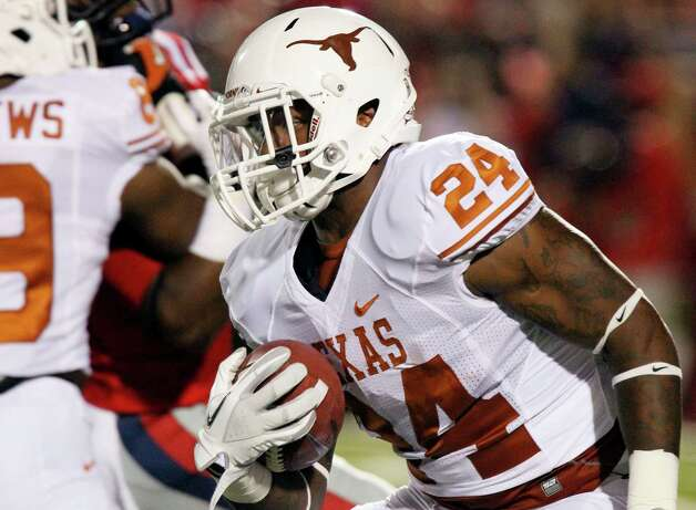 Texas running back Joe Bergeron carries for a short gain against Mississippi during the first quarter of an NCAA college football game in Oxford, Miss., Saturday, Sept. 15, 2012. (AP Photo/Rogelio V. Solis) Photo: Rogelio V. Solis, Associated Press / AP