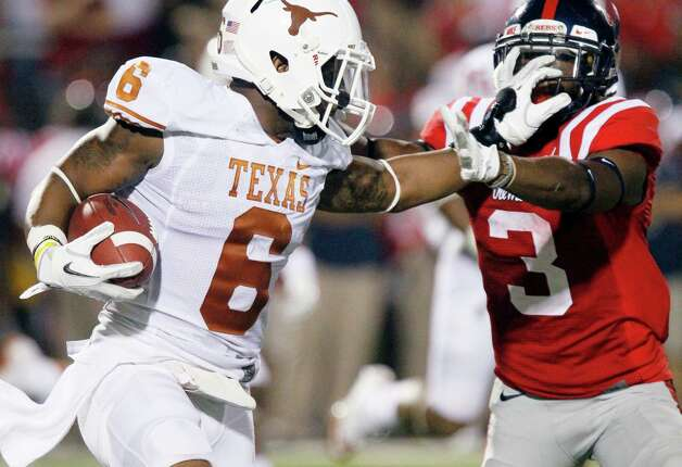 Texas cornerback Quandre Diggs (6) fights off Mississippi running back Jeff Scott (3) as he runs upfield with a 11-yard interception during the second quarter of an NCAA college football game in Oxford, Miss., Saturday, Sept. 15, 2012. (AP Photo/Rogelio V. Solis) Photo: Rogelio V. Solis, Associated Press / AP