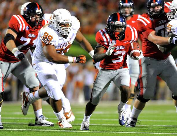 Mississippi running back Jeff Scott (3) runs past Texas defensive tackle Desmond Jackson (99) during the second quarter of an NCAA college football game in Oxford, Miss., Saturday, Sept. 15, 2012. (AP Photo/Austin McAfee) Photo: Austin McAfee, Associated Press / AP
