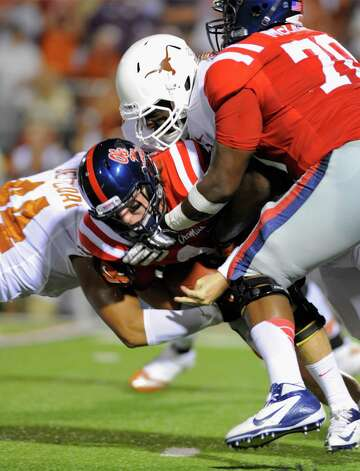 Mississippi quarterback Bo Wallace is sacked by two Texas defenders during the second quarter of an NCAA college football game in Oxford, Miss., Saturday, Sept. 15, 2012. (AP Photo/Austin McAfee) Photo: Austin McAfee, Associated Press / AP