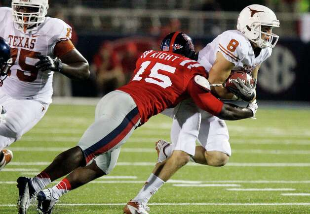 Texas wide receiver Jaxon Shipley (8) is tackled by Mississippi linebacker Joel Kight (15) after a short pass reception in the second quarter of an NCAA college football game in Oxford, Miss., Saturday, Sept. 15, 2012. (AP Photo/Rogelio V. Solis) Photo: Rogelio V. Solis, Associated Press / AP