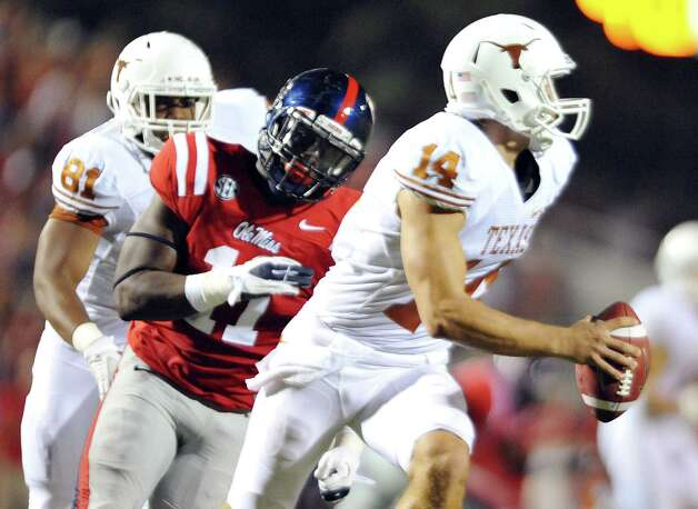 Mississippi defensive end Channing Ward (11) chases Texas' David Ash (14) during an NCAA college football game in Oxford, Miss., on Saturday, Sept. 15, 2012. (AP Photo/Oxford Eagle, Bruce Newman) MAGS OUT  NO SALES  MANDATORY CREDIT Photo: Bruce Newman, Associated Press / OXFORD EAGLE