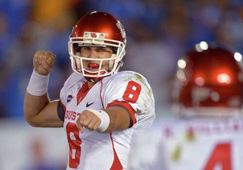 Houston quarterback David Piland signals toward wide receiver Ronnie Williams during the first half of an NCAA college football game against UCLA, Saturday, Sept. 15, 2012, in Pasadena, Calif. (AP Photo/Mark J. Terrill) Photo: Mark J. Terrill, Associated Press / AP