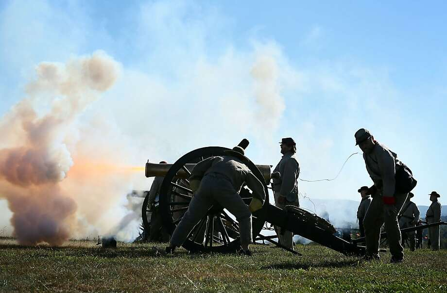 SHARPSBURG, MD - SEPTEMBER 15:  Re-enactors dressed as Confederate soldiers fire a cannon during an event to mark the 150th anniversary of the Battle of Antietam September 15, 2012 in Sharpsburg, Maryland. The Battle of Antietam was fought on September 17, 1862 and was the bloodiest battle in American history with more than 23,000 men killed, wounded, and missing in one single day. It marked the end of General Robert E. Lee's first invasion of the North and led to Abraham Lincoln's issuance of the Emancipation Proclamation.  (Photo by Alex Wong/Getty Images) Photo: Alex Wong, Getty Images