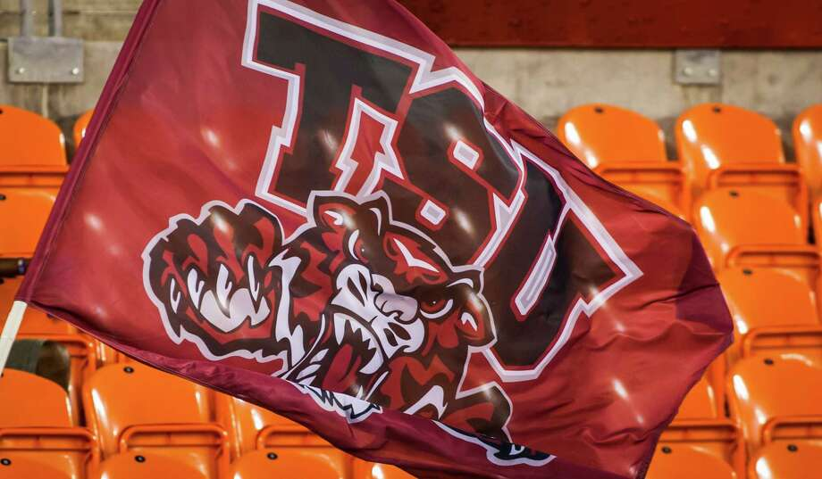 The TSU flag is run across the field following a touchdown during the third quarter of the NCAA football game between the Texas Southern University Tigers and the Jackson State Tigers at BBVA Compass Stadium on  Saturday, Sept. 15, 2012, in Houston. Photo: Andrew Richardson, For The Chronicle / © 2012 Andrew Richardson