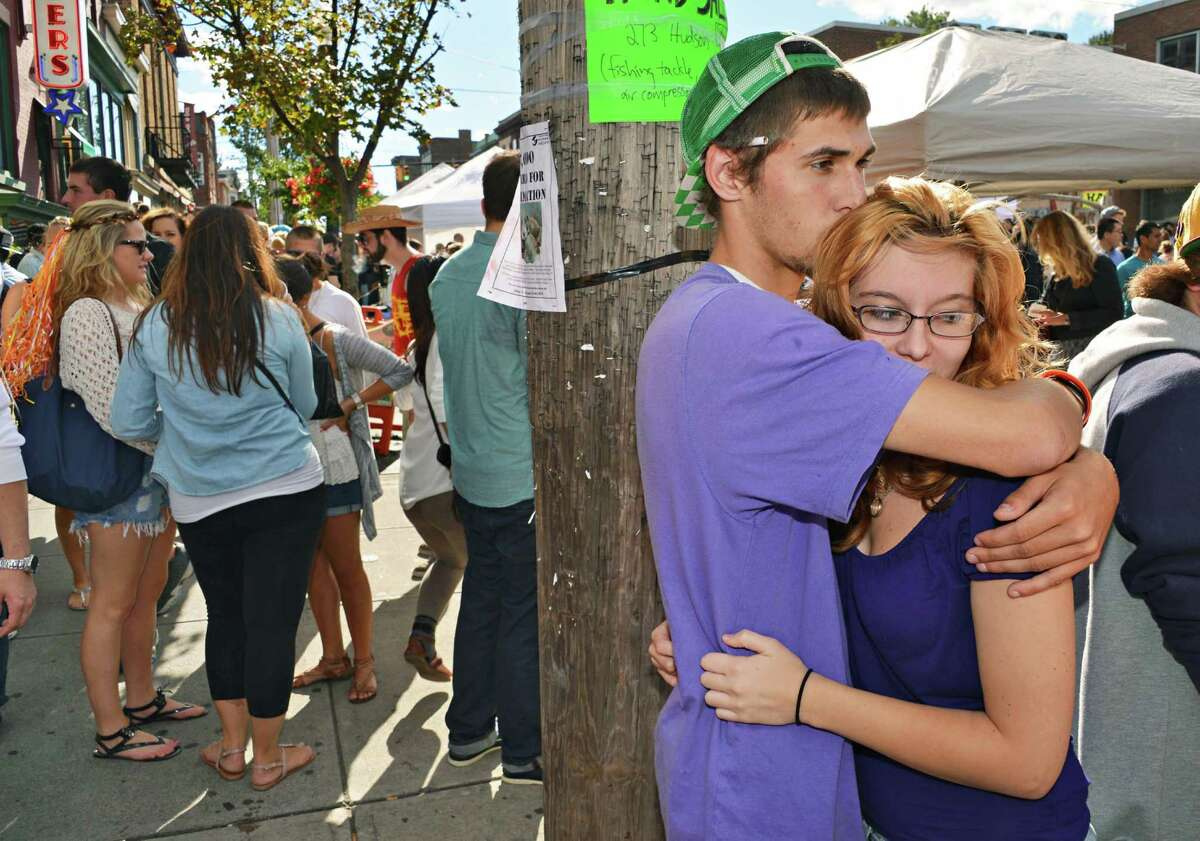 Mike Tucci and Noelle Geroux,at right, both of Ravena, find a quiet sopt amid the crowds at LarkFEST 2012 in Albany on Saturday, Sept. 15, 2012.