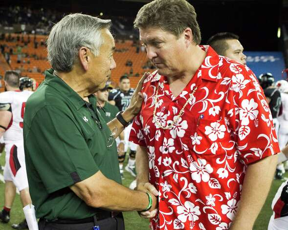 Hawaii head coach Norm Chow, left, shakes hands with Lamar head coach Ray Woodard at the end of the NCAA game between the Lamar and Hawaii, Sept. 15, 2012 in Honolulu.  Hawaii defeated Lamar 54-2.  (AP Photo/Marco Garcia) Photo: Marco Garcia, FRE / FR132415 AP