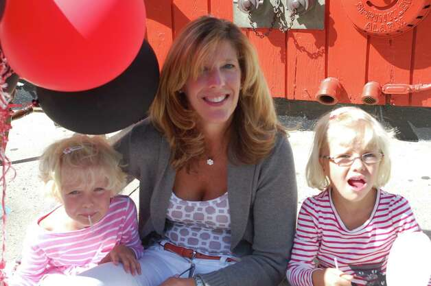 Bettina Calise of Fairfield with her daughters Caleigh, left, and Cameron enjoying the Slice of Saugatuck festival on Saturday. Photo: Jarret Liotta / Westport News contributed