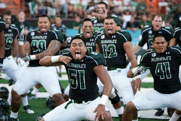 "Hawaii linebacker Lance Williams, center, and his teammates perform a ""haka"" before the start of the NCAA college football game against Lamar on  Saturday, Sept. 15, 2012, in Honolulu.  (AP Photo/Marco Garcia) Photo: Marco Garcia, FRE / FR132415 AP"