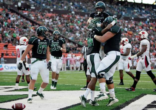 Hawaii wide receiver Trevor Davis (89) celebrates his touchdown with teammates during the first half of an NCAA college football game against Lamar on Saturday, Sept. 15, 2012, in Honolulu.  (AP Photo/Marco Garcia) Photo: Marco Garcia, FRE / FR132415 AP