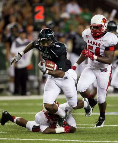 Hawaii running back Will Gregory runs through the Lamar defense during the second quarter of the NCAA game between the Lamar and Hawaii, Sept. 15, 2012 in Honolulu.  (AP Photo/Marco Garcia) Photo: Marco Garcia, FRE / FR132415 AP