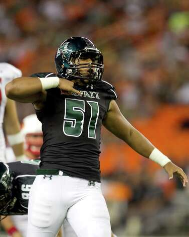 Hawaii linebacker Lance Williams reacts after the defense stopped a Lamar play during the third quarter of the NCAA game between the Lamar and Hawaii, Sept. 15, 2012 in Honolulu.  (AP Photo/Marco Garcia) Photo: Marco Garcia, FRE / FR132415 AP