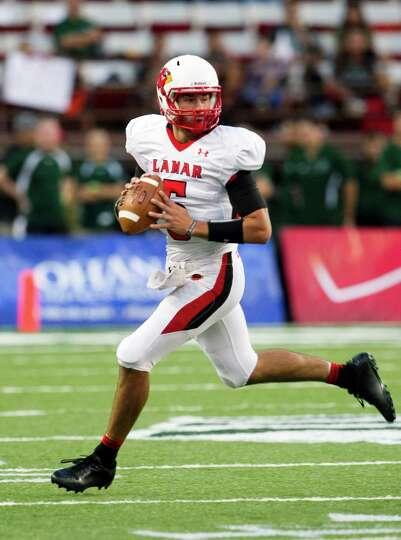 Lamar quarterback Ryan Mossakowski runs the ball during an NCAA college football game against Hawaii