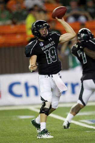 Hawaii quarterback Sean Schroeder makes a pass during the second quarter of the NCAA game between the Lamar and Hawaii, Sept. 15, 2012 in Honolulu.  (AP Photo/Marco Garcia) Photo: Marco Garcia, FRE / FR132415 AP