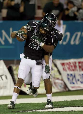 After Hawaii special teams blocked a punt, Hawaii defensive back Ne'Quan Phillip, left, and Kendrick Van Ackeren celebrate after Phillips  returned the ball for a touchdown during the second quarter of the NCAA game between the Lamar and Hawaii, Sept. 15, 2012 in Honolulu.  (AP Photo/Marco Garcia) Photo: Marco Garcia, FRE / FR132415 AP