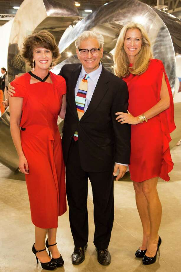 Melissa Grobmyer, left, fair CEO Rick Friedman and  Janet Hobby Photo: Bruce Bennett / Houston Chronicle