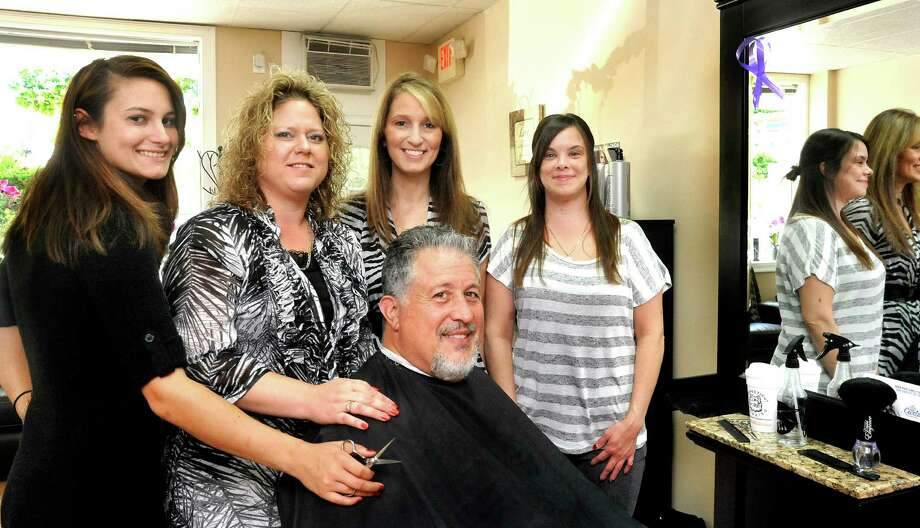 Staff members of the Danbury hair salon Christie & Company stand behind customer John Cerullo Saturday, Sept. 15, 2012. From left are Amelinda Manka, Lisa Reiss, Christie Cardinale and Nicole Nathanson. Photo: Michael Duffy / The News-Times